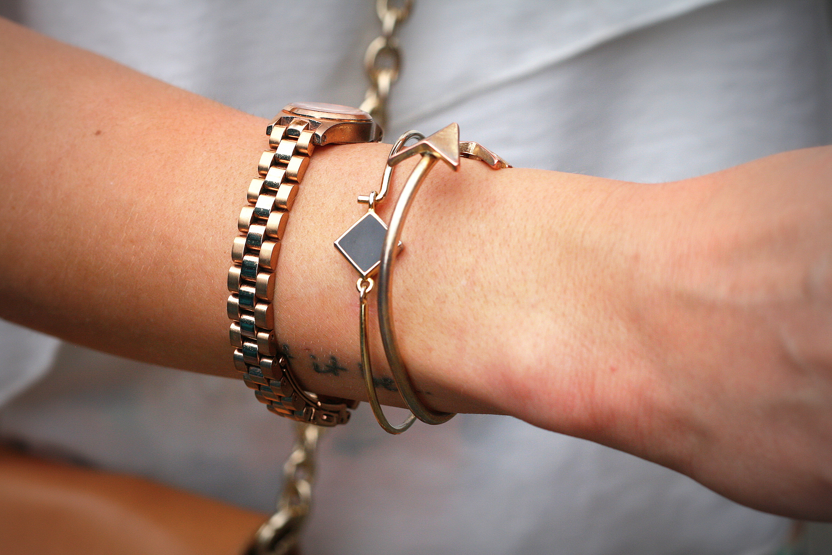 Watch by Marc jacobs & Braclets by Akira & American Apparel. Ooh, do we see a chic little tatoo? It says...Let it be. That's what we LOVE- easy going chic attitude!