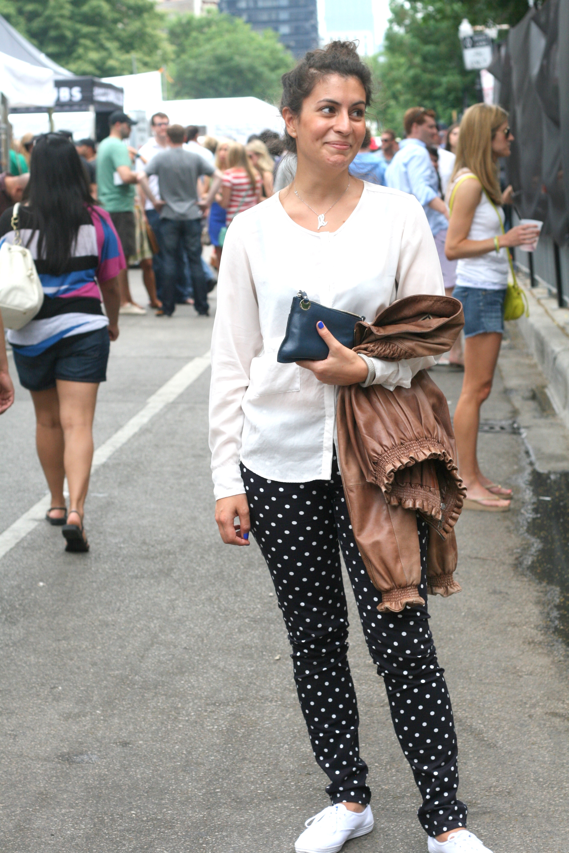 Ms. Al Sharifa's Polka Dot trousers by Max & CO., Shirt by Penny Black, Shoes are Keds and the Pochette is by PennyBlack