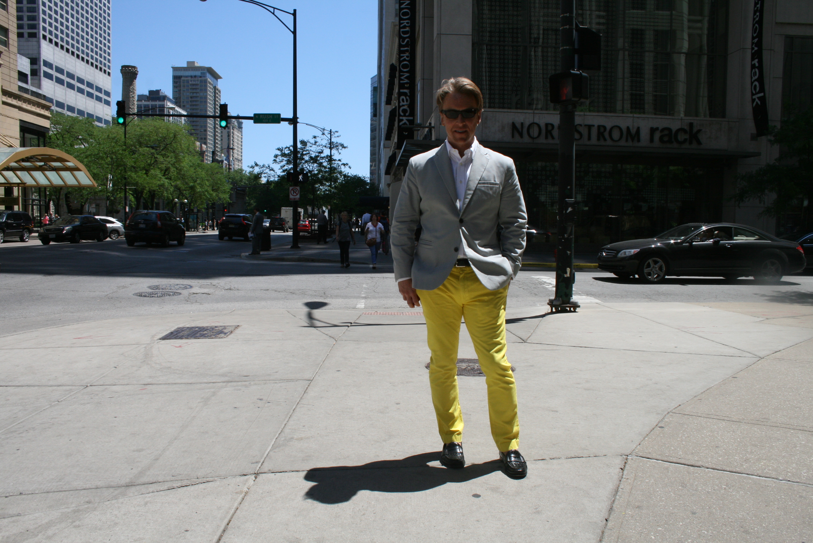 Mr. Andrew Shea is from the East Coast and enjoys dressing in European Bespoke outfits. He is currently wearing J Crew trousers and a Bespoke tailored men's suit